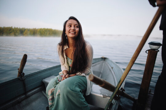 Beautiful native American girl waits patiently on her row boat