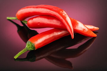 Canvas Prints Hot chili peppers red hot long chili pepper on a red dark background
