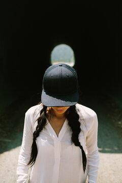 baseball cap + pigtails