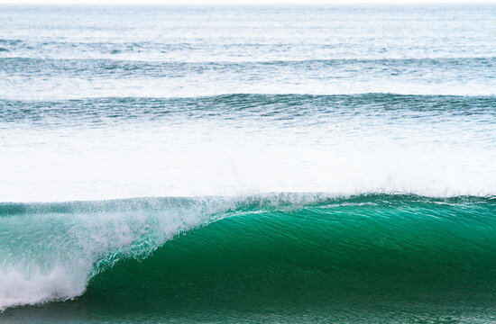 Peeling wave with offshore wind in California.