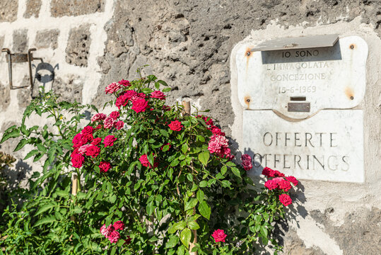 Sorrento, Italy. July 17th, 2020. Along the road that leads to Marina Grande, on a wall you can see a crack with the inscription Offerings, to collect the offers of travelers.