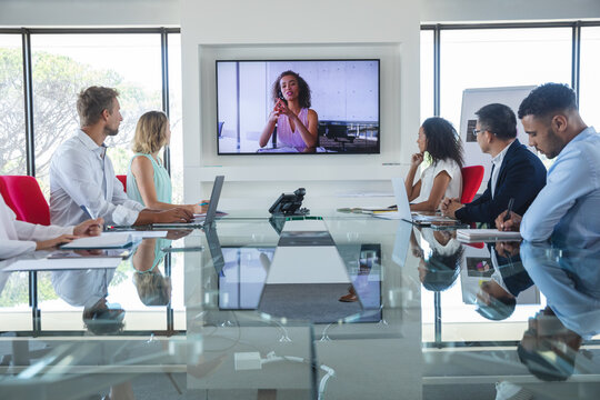 Professional businesspeople in video conference in meeting room in modern office