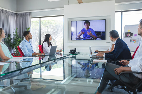 Professional business people in video conference in meeting room in modern office