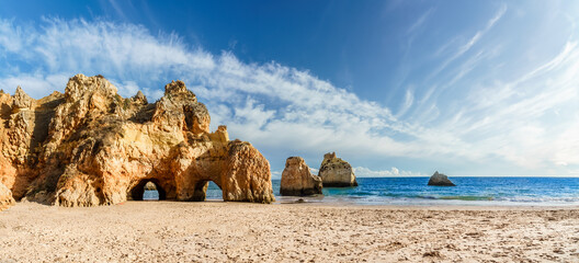 Wall Mural - Landscape with Praia dos Tres Irmaos, famous beach in Algarve, Portugal
