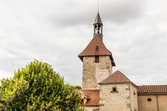 Charroux, France. Half-timbered house and church tower in one of the most beautiful villages in the Allier department in Auvergne