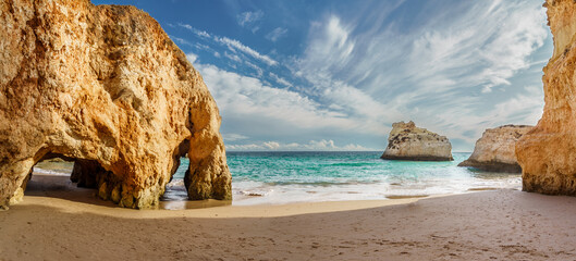 Wall Mural - Amazing karst formations in Praia dos Tres Irmaos, famous beach in Algarve, Portugal