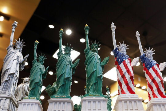 Replicas of the Statue of Liberty are seen for sale in a store in the Times Square area of Manhattan, New York City