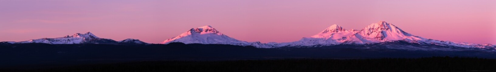 Sunrise panorama image of the  three sisters mountains and broken top
