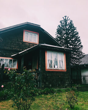 Old wood house in the woods in a cloudy and rainy day, Puerto Varas
