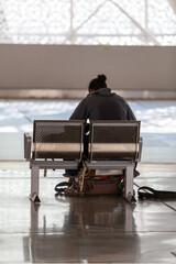 Passenger waiting for transit bus in San Francisco station