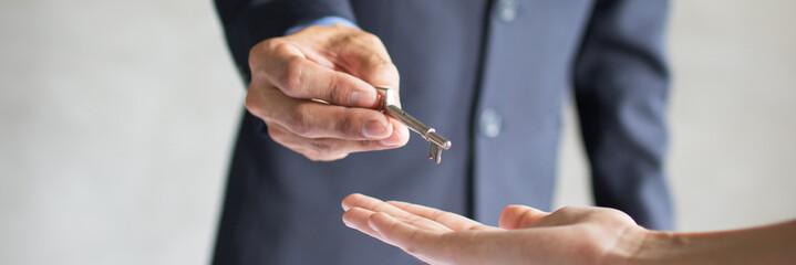 Bank agent give key of apartment or resident to young couple after successful discussing and...