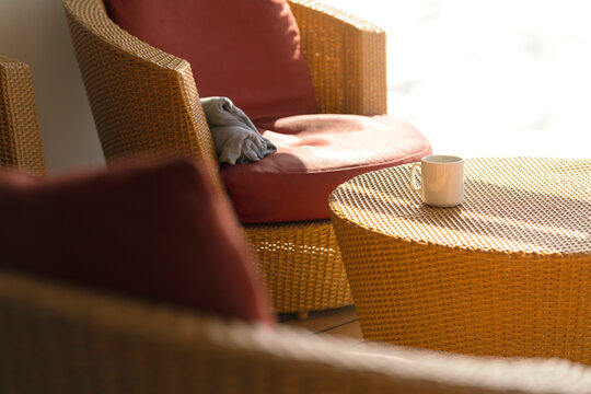 morning casual weekend with hot drink coffee on rattan table on wooden patio sunshine from window casual relax deas concept