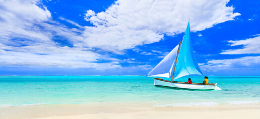 Tropical paradise. Mauritius island holidays, Le Morne beach. View with traditional boat