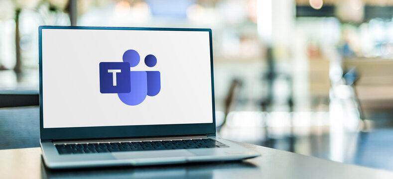 Laptop computer displaying logo of Microsoft Teams