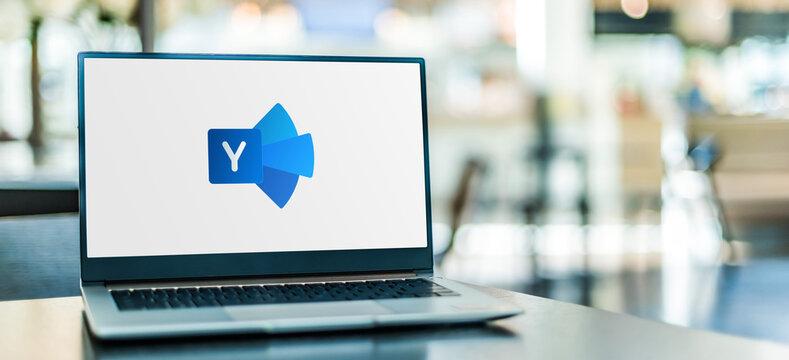 Laptop computer displaying logo of Yammer