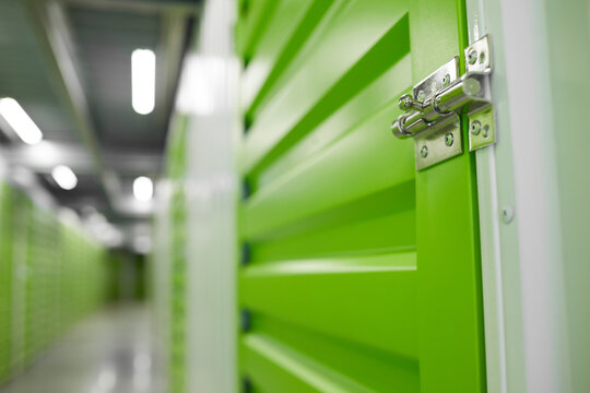 Close up background image of storage facility with focus on lock latch on container door, copy space