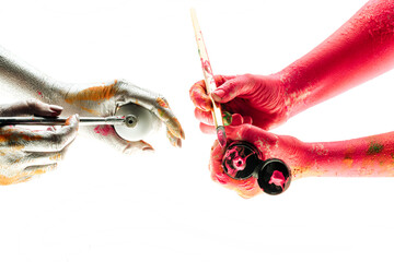 Modern art and process of creation. People coloring their hands in different colors. Concept of...