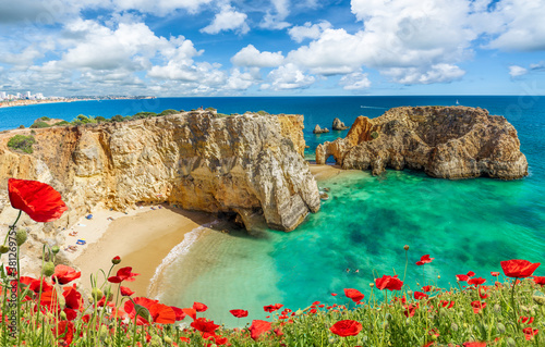 Wall mural Amazing landscape with cliff, beach and turquoise water in Algarve, Portugal