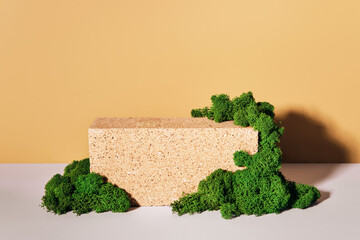 Mockup podium made of Brick and moss for products and accessories. Front view, biophilic design