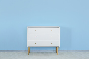 Wall Mural - Modern chest of drawers near color wall in room