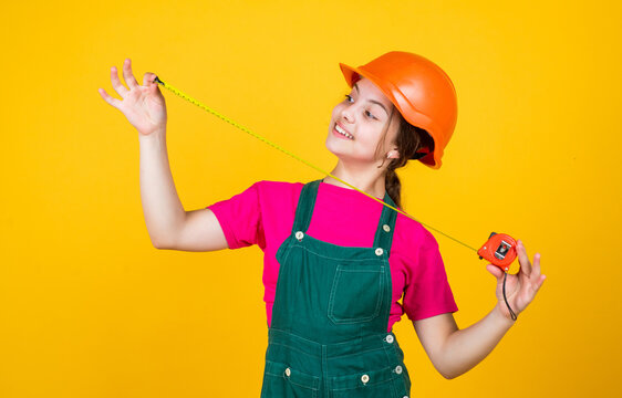 growing concept. little girl with measuring tape. instruments for renovation apartment. childhood happiness and development. measuring the height. architect. playing with tools. Welcome to my world