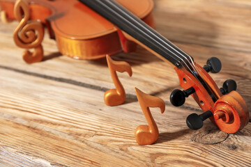Violin with music notes on table