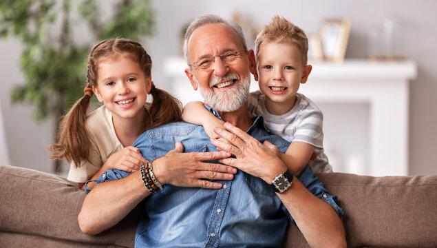 Happy senior woman hug grandkids.