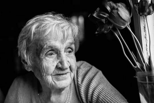 Portrait of an old woman. Black and white photography.