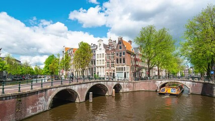 Wall Mural - Amsterdam city skyline in Amsterdam, Netherlands time lapse
