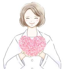 花びらで作ったピンクのハートを持った笑顔の女医