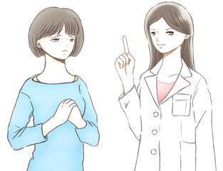 不安そうな顔の女性と白衣を着た女性