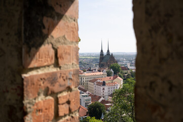 Cathedral of Saint Peter and Paul (Katedrala svateho Petra a Pavla), Petrov, Brno, Czech Republic / Czechia. View from Spilberk castle. Shallow focus with blurred  masonry.