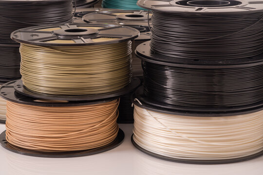 Many PLA and ABS filament spools for 3D printer.