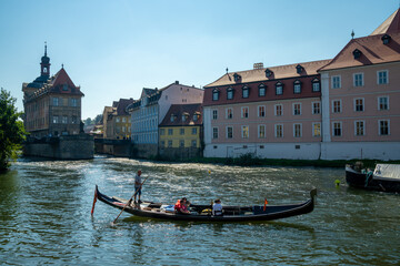 the Regnitz river in Bamberg with a gondola on a ruise