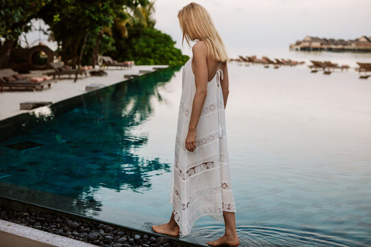 Female tourist at an infinity pool