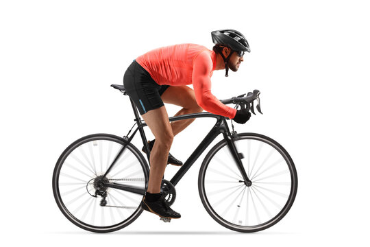 Profile shot of a male cyclist riding a road bicycle with spinning wheels