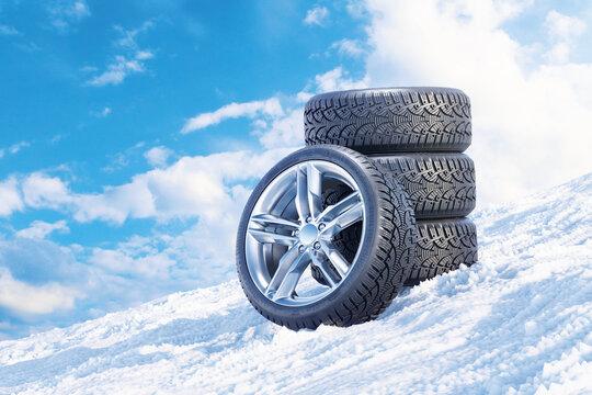 Car wheels on a snowy mountain slope 3D