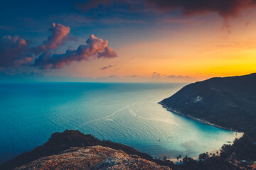 Silhouette Asia sunset aerial ocean bay at mountain forest, beach coast of Koh Tao Island, Thailand. Epic Thai landscape at warm sun set tones at cloud sky. Exotic isle in romantic cinematic view