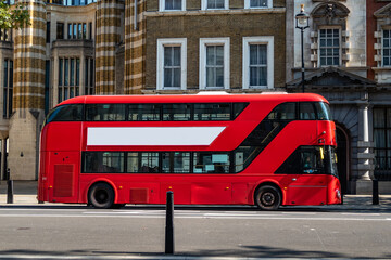 Red London Buses operating during lockdown pandemic in Central London, UK due to Covid19 coronavirus.