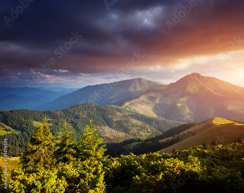 Wall mural Beautiful sunset in the summer mountains.