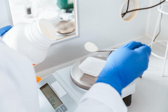 Pharmacist weighing chemical