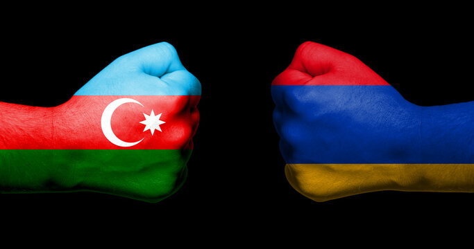 Concept of relations/conflict between Armenia and Azerbaijan symbolized by two opposed clenched fists with the two countries flags
