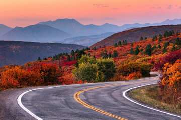 Winding mountain road and autumn landscape. Fotomurales