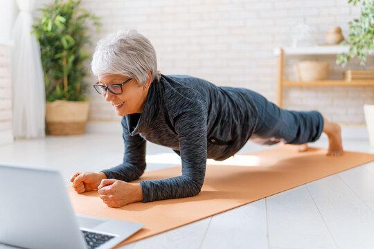 Senior woman exercising at home.