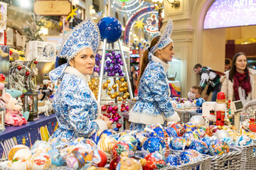 MOSCOW, RUSSIA - December 18, 2019. GUM Main Department Store. New Year and Christmas fair. Sellers in national costumes. Presents for tourists
