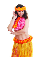 Beautiful young female dancer in traditional Hawaii dress in with orange skirt and flower wreath in her hair in various poses