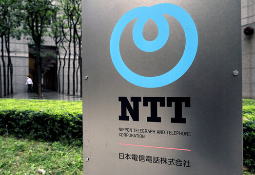 The logo of NTT (Nippon Telegraph and Telephone Corporation) is displayed at the company office in Tokyo