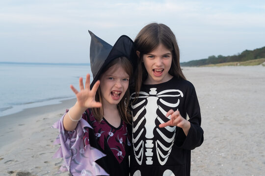 children in costumes celebrate halloween at sea