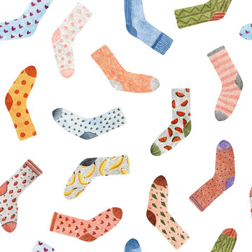 Set of socks on a white background seamless pattern. Print drawn with pencils on paper. Cozy autumn and winter illustration. New Year and Christmas wallpapers.