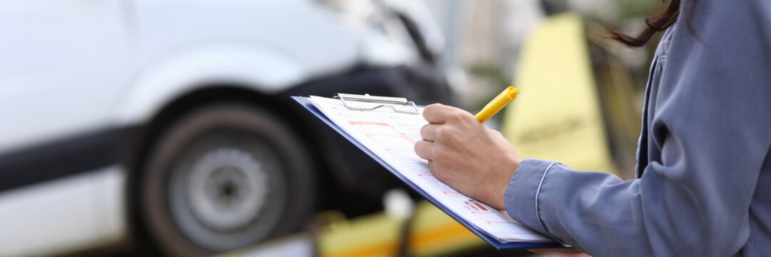 Insurance agent fills out paperwork after accident. Third party liability insurance for vehicle owners concept